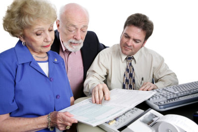 senior couple with their accountant