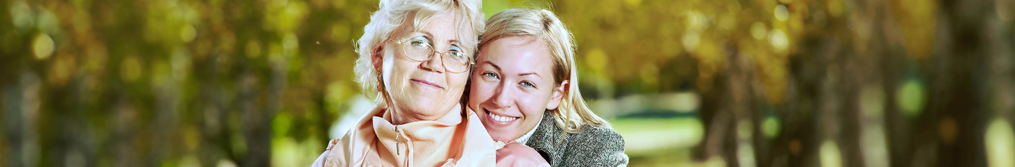 woman and senior woman smiling
